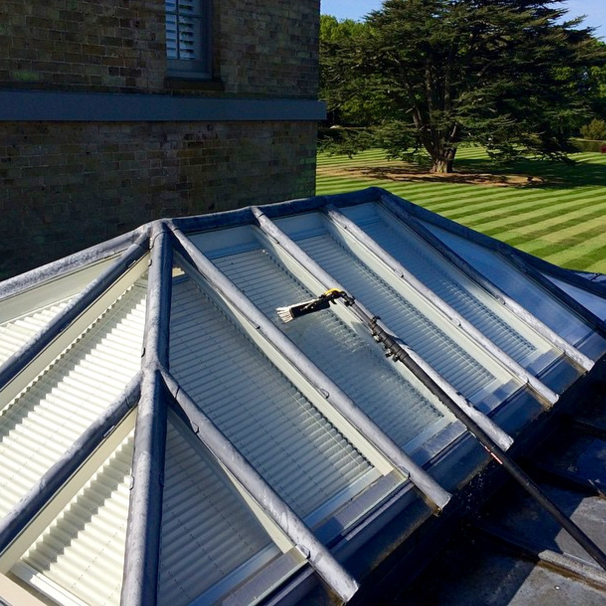 Water fed pole cleaning conservatory roof